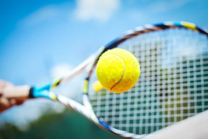 tennis-ball-and-racket-istock-480440650