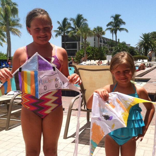 Children pool side doing crafts