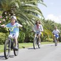 Family enjoying bike ride