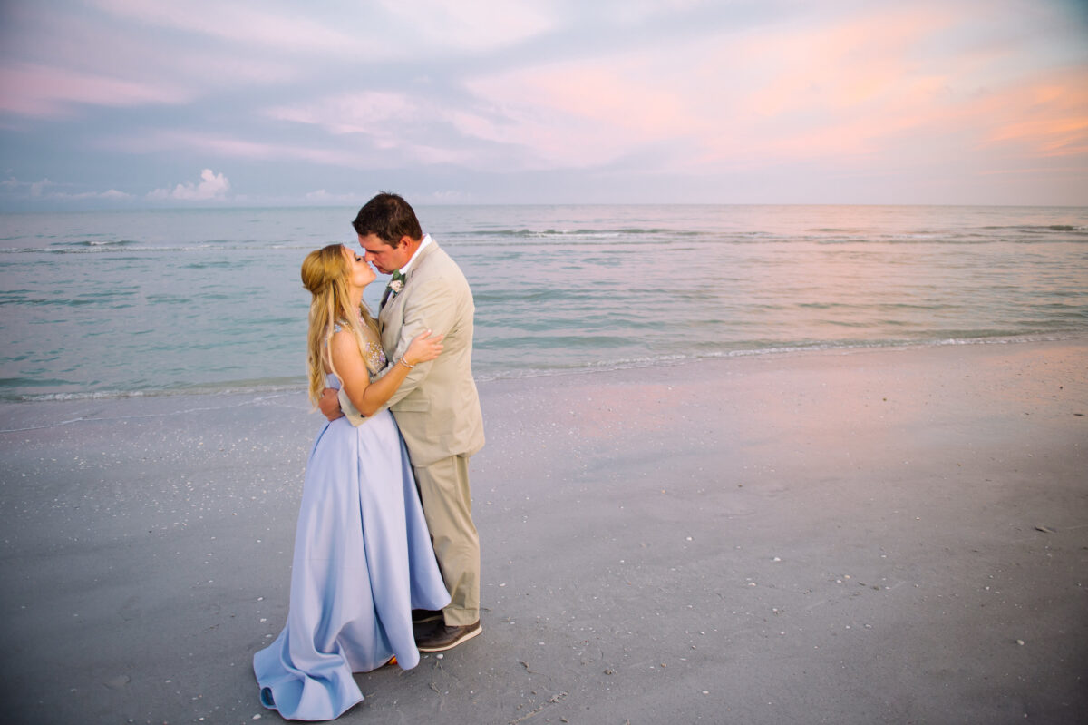 bride and groom on beach sanibel