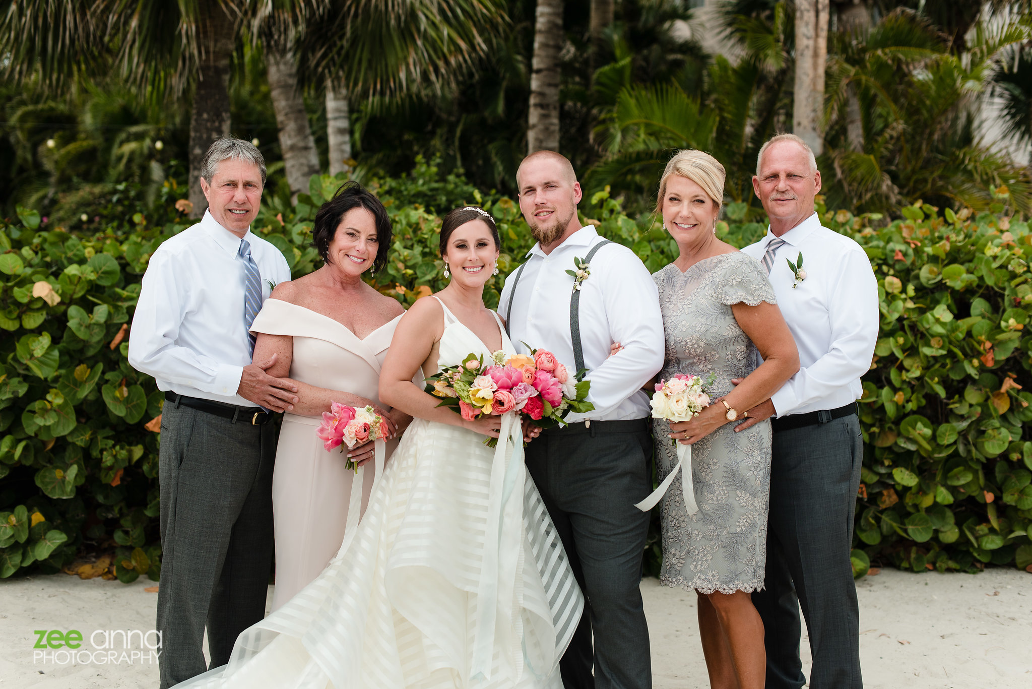 bride and groom with parents photography destination wedding sanibel