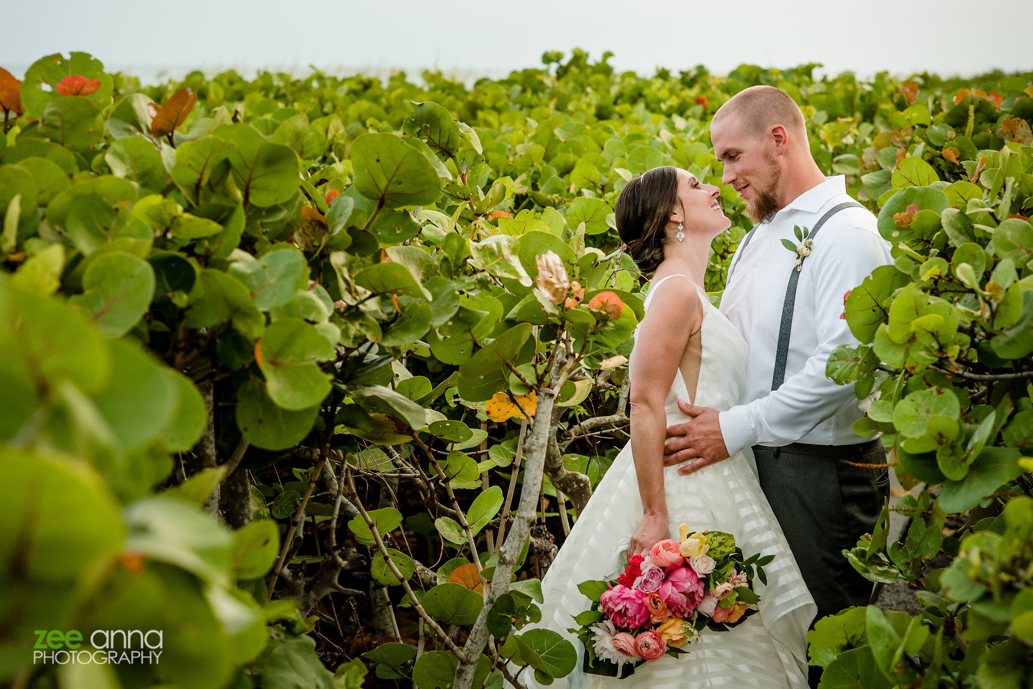 wedding couple photo greenery plants island