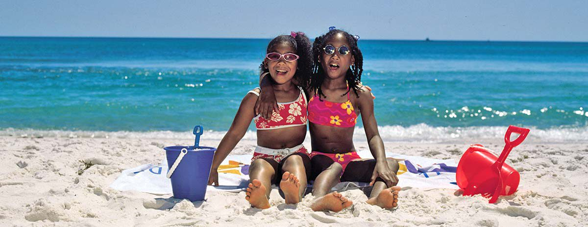 Two girls playing on the sundial beach
