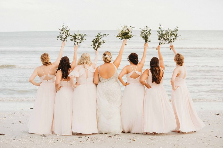 bride and bridesmaid group photo beach sanibel